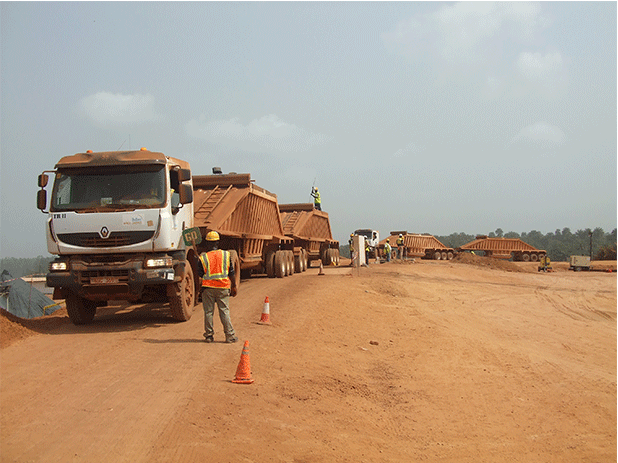 Fleet of 20 lorries transport the iron ore to the barge.