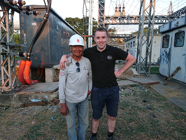Senior Electrical Engineer Eugene Devlin with site employee