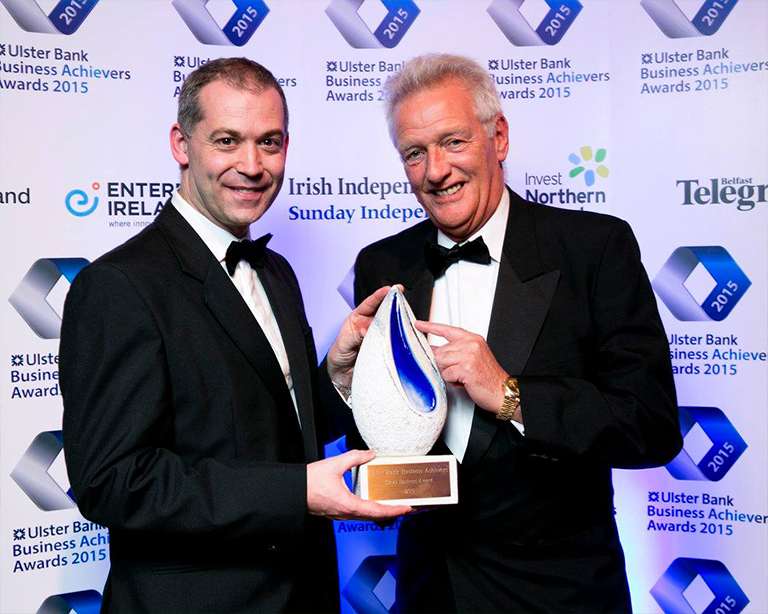 Nigel Walsh (left), Head of Sectors and Specialist Sales, Ulster Bank, presenting  AJ Power Managing Director Ashley Pigott (right) with the Small Business Award.